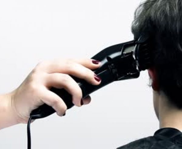 stock-footage-client-hair-cut-at-hairdresser